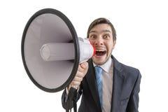 Mannen meddelar annonseringen med megafonen bakgrund isolerad white Fotografering för Bildbyråer
