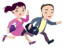Mannen och kvinnan kör sent för din egen transport Arkivbild