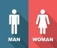 Mannen och kvinnan skuggar länge framlänges Royaltyfri Fotografi