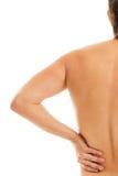 Mannen rymmer hans baksida smärtar tack vare Royaltyfri Fotografi