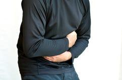 mannen smärtar magen fotografering för bildbyråer