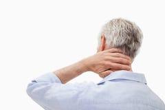 Mannen som har en hals, smärtar fotografering för bildbyråer