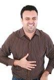 Mannen som lider från en dålig mageknip, smärtar Royaltyfria Foton