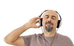 Mannen som lyssnar till musiken Royaltyfria Foton
