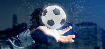 Mannen som rymmer en fotbollboll och anslutning, isolerade renderinen 3d Arkivbilder