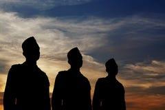 mannen ståtar silhouette tre Arkivbilder