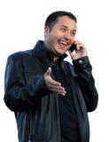 Mannen talar på telefonen Royaltyfri Bild