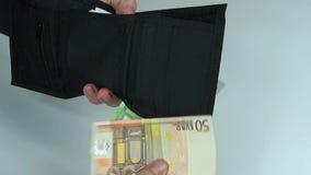 Mannen tar pengar arkivfilmer