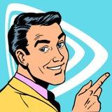Mannen visar riktningen av ditt finger och ler Arkivbild