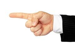 Mannens hand som isoleras på en vit bakgrund, indikerar riktningen Arkivfoton