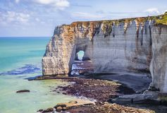 The Manneporte Natural Stone Arch in Normandy. Low tide landscape featuring the `The Manneporte` natural stone arch, closed to Etretat in Normandy, France Stock Photo