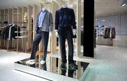 Manneqiuns in section of men clothes in shop Stock Image