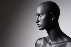 Mannequin. Beautiful mannequin standing alone on a grey background Royalty Free Stock Photo