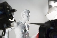 Mannequin ad una sessione di foto Immagine Stock