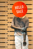 Mannequin announces sale. In boutique window stock photos