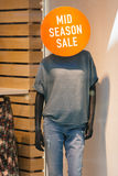 Mannequin announces sale. Mannequin announces mid season sale in boutique window stock image