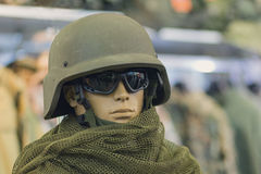 Mannequin in an army helmet and tactical goggles. Weapons Stock Image