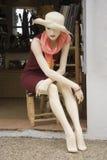 Mannequin auf einem Stuhl Lizenzfreie Stockbilder