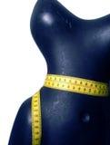 Mannequin avec la bande de mesure Images stock