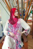 Mannequin in baju kurung. Mannequin in shop with batik fashion Royalty Free Stock Photos