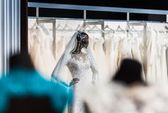 The mannequin in a beautiful wedding attire of the bride. The mannequin looking as liquid terminator, in a beautiful wedding attire of the bride, shining the Stock Photography