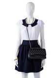 Mannequin with black quilted purse. Stock Photography