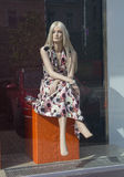 Mannequin - blonde sitting and looking in the shop windows Royalty Free Stock Images