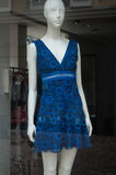 Mannequin with blue dress in a fashion showroom Royalty Free Stock Photography