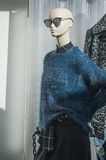 Mannequin with blue pullover and sun glasses. In a women fashion store Stock Photography