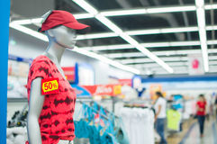 Mannequin with cap and t-shirt and discount label Stock Photo