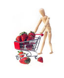 Mannequin carriyng strawberries Royalty Free Stock Images