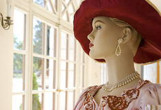 64b8ef54d41cc Mannequin in red hat. Mannequin in castle royalty free stock photography