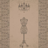 Mannequin and chandelier with lace border Stock Photos