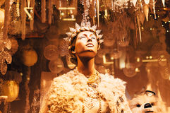 Mannequin and Christmas decorations in the shopping window of Brown Thomas Dublin. Dublin, Ireland - December 11, 2016: Mannequin and Christmas decorations in Royalty Free Stock Images