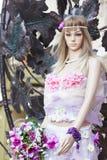 Mannequin con i flowerets Fotografia Stock