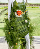 Mannequin covered with leaves and flowers Royalty Free Stock Photos