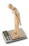 Mannequin, das auf der digitalen Skala steht stockfoto