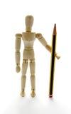Mannequin di legno che tiene una matita Fotografia Stock Libera da Diritti