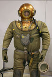 The mannequin is dressed in a. Diving suit with a round copper helmet and a cargo on a breast, and in hands he holds a lantern Royalty Free Stock Image