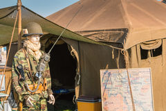 Mannequin dressed in military front of a tent Stock Photo