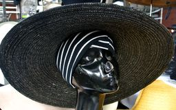 The hats exposition. Mannequin face and exposition hats Royalty Free Stock Images