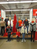 Mannequin family displaying clothes Stock Photos