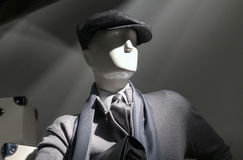 Mannequin in gray (horizontal). Mannequin in gray sweater, cap, striped shirt, scarf and tie Royalty Free Stock Photos