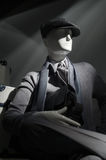 Mannequin in gray (vertical). Mannequin in gray sweater, cap, striped shirt, scarf and tie Stock Photo