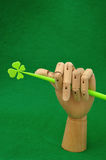 A mannequin hand holding a four leaf clover Stock Photography