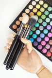Mannequin hand with makeup brushes, colorful makeup Royalty Free Stock Photography
