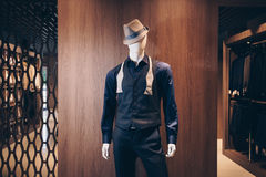 Mannequin in hat. Mannequin in a classic suit and hat resembling a gangster. Shop of costumes Stock Photo