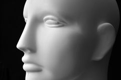 Mannequin Head. Front view of a mannequin dummy head isolated on a black background Stock Photo