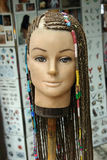 Mannequin head. A mannequin head displaying braids for sale in the Caribbean Islands stock images