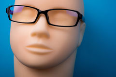 Mannequin head with black eyeglasses on background Stock Photo